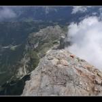 Dalla cima: il mio compare sotto e più giù il lago di Alleghe